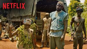 Abraham Attah (left) and Idris Elba in scene from Beasts of No Nation