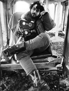 "Photographer Dmitri Kasterine's favorite photo of Stanley Kubrick, featuring Kubrick taking a break, waiting for the rain to stop, during filming of ""A Clockwork Orange."""