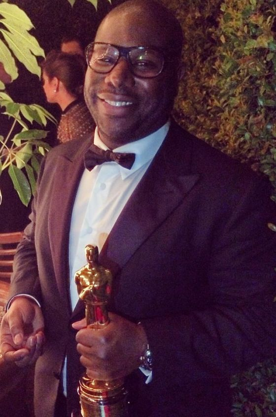 Steve McQueen holding the Best Picture Oscar statuette for 12 Years a Slave, March 2014