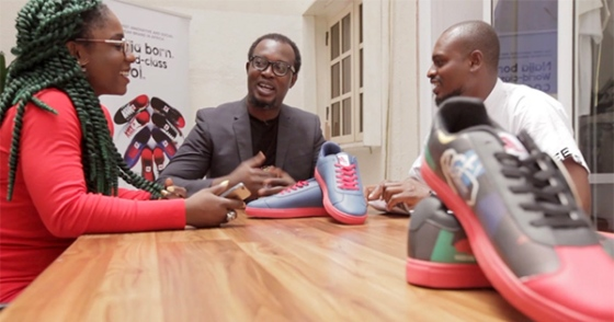 Entrepreneur Jide Ipaye (center), founder of the Keexs smart shoe